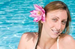 Smiling young woman with lotus flower Royalty Free Stock Photo