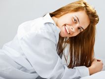 Smiling young woman lying on the floor Stock Images