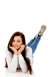 Smiling young woman lying on floor.  Royalty Free Stock Photo