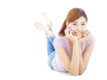 Smiling young woman lying on the floor Stock Photography