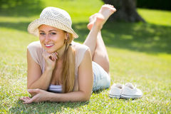 Smiling young woman lying on grass Stock Image