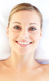 Smiling young woman lying on a massage table Stock Image