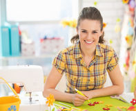 Smiling young woman making easter decoration Stock Photography