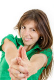 Smiling young woman making with hands fingers sign like shooting Stock Photo