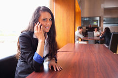 Smiling young woman making a phone call Royalty Free Stock Images