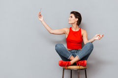 Smiling young woman making selfie photo on smartphone Royalty Free Stock Images