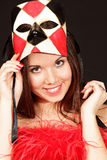 Smiling young woman in mask Stock Photography
