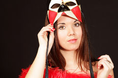 Smiling young woman in mask Stock Image