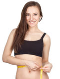 Smiling young woman measuring her waist Stock Images