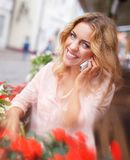 Smiling young woman with mobile phone Stock Photos