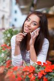 Smiling young woman with mobile phone Stock Photo
