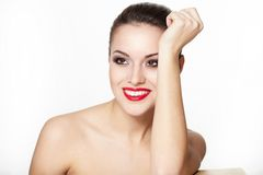 Smiling young woman model with glamour red lips. Closeup portrait of sexy smiling caucasian young woman model with glamour red lips,bright makeup, eye arrow Stock Photo