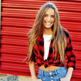 Smiling young woman in modern casual clothes Stock Photos