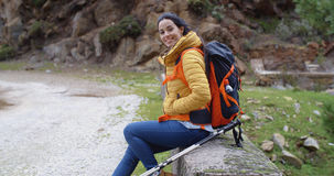 Smiling young woman on a mountain trail Stock Image