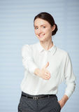 Smiling young woman offering a handshake Stock Photography