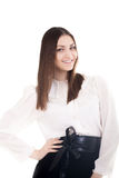 Smiling young woman in office attire on white background Royalty Free Stock Photos
