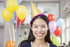 Smiling Young Woman At Office Party Stock Image