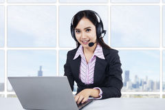 Smiling young woman operator Stock Image