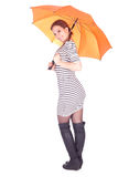 Smiling  young woman with orange umbrella Stock Image