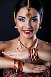 Smiling young woman with oriental makeup and Indian Jewelry. Beautiful girl with oriental makeup and Indian Jewelry, fashion look stock photos