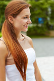 Smiling young woman outdoors Stock Photography