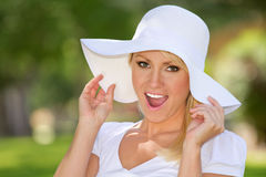 A Smiling Young Woman Outside. A young blonde smiling woman outside royalty free stock image