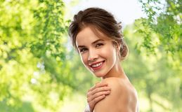 Smiling young woman over natural background stock photography