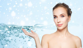 Smiling young woman over water and snow Stock Photography