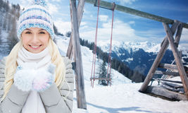 Smiling young woman over winter landscape Royalty Free Stock Photography