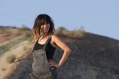 Smiling Young woman in overalls Royalty Free Stock Photos