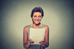 Smiling young woman with papers Royalty Free Stock Photo