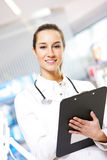 Smiling young woman pharmacist Stock Image