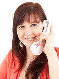 Smiling young woman on the phone Stock Images