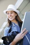Smiling young woman photographer using tablet Royalty Free Stock Images