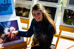Smiling Young Woman On Photography Exhibition Royalty Free Stock Photography