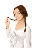 Smiling young woman with pigtails flirting Stock Photography