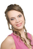 Smiling young woman in a pink blouse Royalty Free Stock Photography