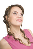 Smiling young woman in a pink blouse Royalty Free Stock Images