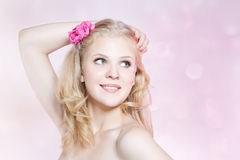 Smiling young woman with pink flowers Stock Photography