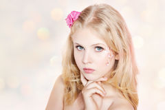 Smiling young woman with pink flowers Stock Photo