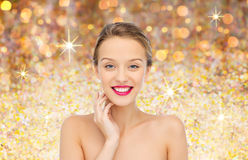 Smiling young woman with pink lipstick on lips Royalty Free Stock Images