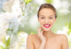 Smiling young woman with pink lipstick on lips Stock Images