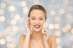 Smiling young woman with pink lipstick on lips Royalty Free Stock Photos