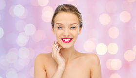 Smiling young woman with pink lipstick on lips Stock Photography