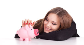 Smiling young woman with pink piggy bank Royalty Free Stock Photo
