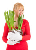 Smiling young woman with plant Stock Photos