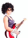 Smiling young woman play guitar over white Stock Photography