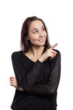 Smiling young woman pointing Royalty Free Stock Images
