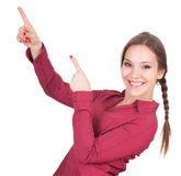 Smiling young woman pointing up Stock Photography