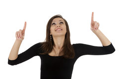 Smiling young woman pointing up Stock Image